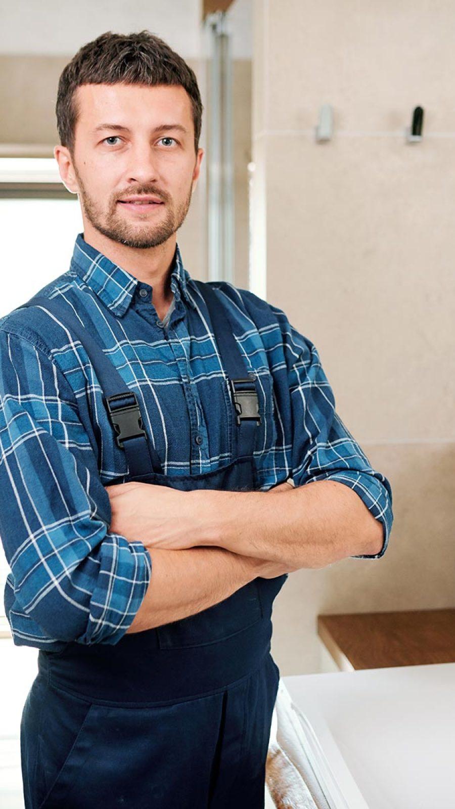 young-successful-plumber-in-workwear-standing-in-b-3P7U6YB.jpg